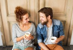 Young couple moving in new house, resting. Stock Image