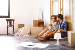 Young couple moving in a new house. Royalty Free Stock Images