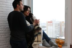 A young married couple in a new apartment royalty free stock images