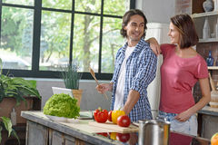 Young married couple preparing healthy food Stock Images