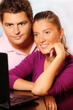 Young married couple searching the Internet Royalty Free Stock Images