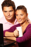 Young married couple searching the Internet Stock Photo