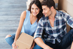 Young married couple sitting in their new house Royalty Free Stock Images