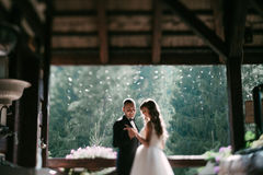 Young married couple standing face-to-face at the balcony and holding hands.  Stock Photos