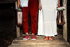Young married couple  with suitcases. Young married couple standing together with suitcases Stock Photo