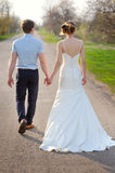 Young married couple walking on a countryside trail Stock Photos