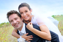 Young married standing in countryside Stock Photos