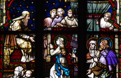 Young Mary in the temple. Stained glass. Stained glass window of a young Mary in the temple stock image