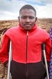 Young Masai with crutches Stock Photos