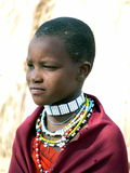 Young Masai girl in traditional dress and jewellery Royalty Free Stock Images