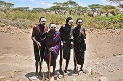 Young Masai men. SERENGETI- TANZANIA - OCTOBER 20: Unidentified Young Masai men (Moran) wear black and markings for several months following their circumcision Royalty Free Stock Photo