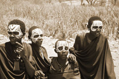 Young Masai men. SERENGETI- TANZANIA - OCTOBER 20: Unidentified Young Masai men (Moran) wear black and markings for several months following their circumcision Royalty Free Stock Photography