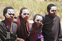 Young Masai men. SERENGETI- TANZANIA - OCTOBER 20: Unidentified Young Masai men (Moran) wear black and markings for several months following their circumcision Stock Photo