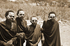 Young Masai men. SERENGETI- TANZANIA - OCTOBER 20: Unidentified Young Masai men (Moran) wear black and markings for several months following their circumcision Stock Image