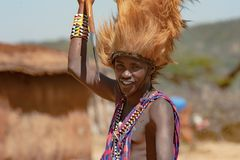 Maasai man, warrior, male lion mane on head, spear in hand, Tanzania royalty free stock images