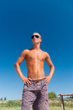 Young masculine man posing at the beach Royalty Free Stock Photography