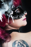 Young masked redhead seductive girl Royalty Free Stock Image