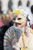 Young masked woman with fan at the Carnival of Venice Royalty Free Stock Image