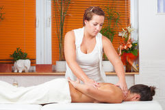 Young massage therapist giving a massage Royalty Free Stock Photo