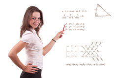 Young math teacher. Trigonometry and algebra formula in background Stock Image