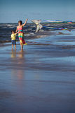 Young mather and her son playing with kite. On the beach Royalty Free Stock Photo