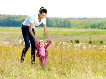 Young mather with smiling beby on nature Stock Images