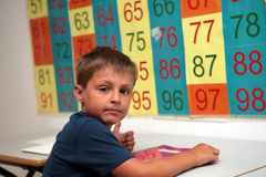 Young maths student in classroom Stock Image