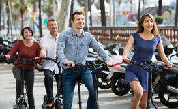 Young and mature couples staying with bikes outdoor Royalty Free Stock Images