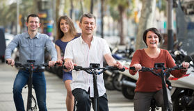 Young and mature couples staying with bikes outdoor Royalty Free Stock Photography