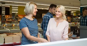 Young and middle-aged woman blonde doing shopping in a supermark Stock Photography
