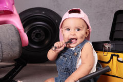 Young mechanic. Young beautiful girl working like mechanic royalty free stock photography