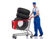 Young mechanic buy tires for the car Royalty Free Stock Image