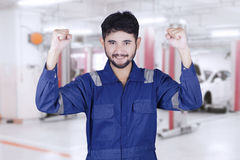 Young mechanic expressing his success Stock Image