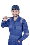 Young mechanic holding tool Stock Image