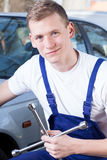 Young mechanic holding a tool Stock Image