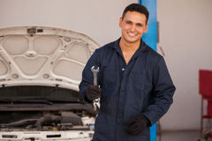 Young mechanic loving his job Royalty Free Stock Photography