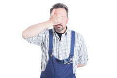 Young mechanic man  making the see no evil gesture Stock Photography