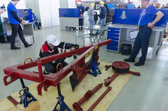 Young mechanic passes competition stage.Tyumen Stock Image