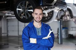 Young mechanic with tool in service. Young mechanic with tool in car service royalty free stock photography