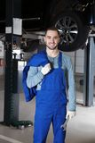 Young mechanic with tool in service. Young mechanic with tool in car service royalty free stock images