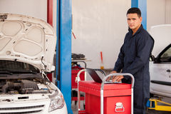 Young mechanic using a computer Stock Photo