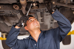Young mechanic working on a car Royalty Free Stock Photos