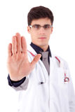 Young medic making stop sign Royalty Free Stock Photography