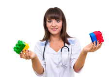 Young medic pediatrician with toys Stock Photo