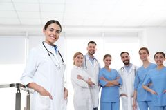 Young medical doctor with colleagues. Unity concept stock images