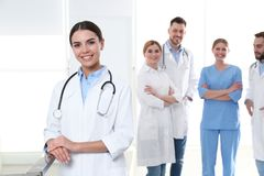 Young medical doctor with colleagues. Unity concept stock photo