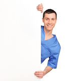 Young medical doctor holding a blank billboard Royalty Free Stock Images