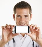 Young medical doctor man showing screen of smartphone. Isolated. Stock Photo