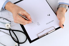 Young medical doctor prescribing something/ Cardiogram of the he Royalty Free Stock Photography
