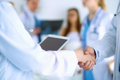 Young medical people handshaking at office Stock Photography